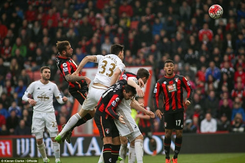 Cook (centre) rises highest to score a 78th minute winner for Bournemouth against Swansea at the Vitality Stadium on Saturday