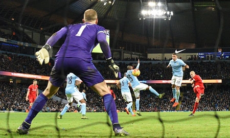 Liverpool defender Martin Skrtel fires the ball past Manchester City goalkeeper Joe Hart to make it 4-1