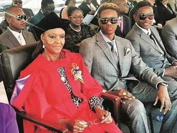 Dr Grace Mugabe at her graduation with sons Robert Junior and Chatunga