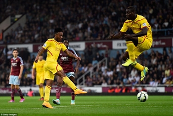 Sterling strikes an unstoppable shot through West Ham's defence as Balotelli jumps out of the way to bring Liverpool back to 2-1 in the first half
