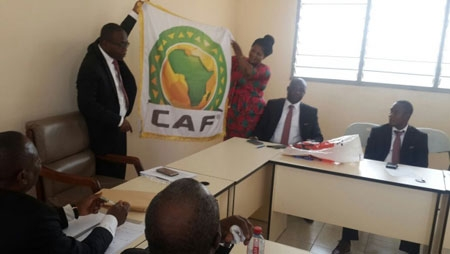 GFA officials open up the CAF flag/banner