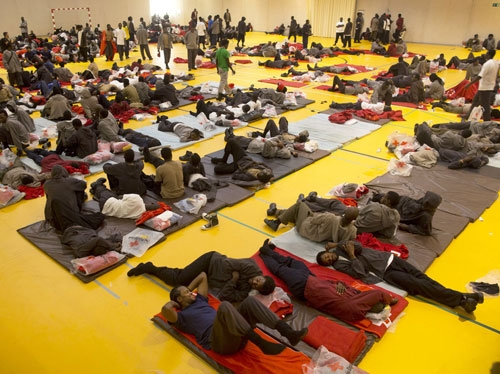 African migrants rest inside a temporary shelter at a sport center on in Tarifa, Spain.