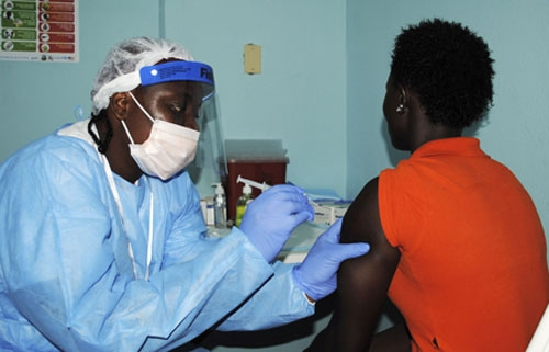 Library image - A health worker injects a woman with an Ebola vaccine in Monrovia on Monday as Liberia