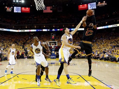 Cleveland Cavaliers guard Kyrie Irving (2) shoots the ball against Golden State Warriors guard Klay Thompson (11) during the fourth quarter in Game 5 of the NBA Finals at Oracle Arena.
