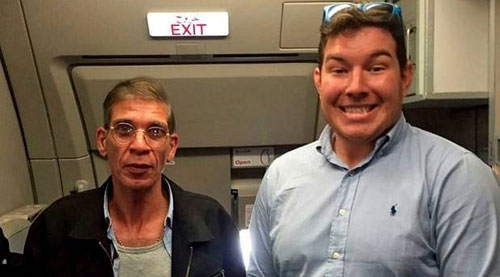 British passenger Ben Innes (R) poses for a photograph alongside the hijacker Photo