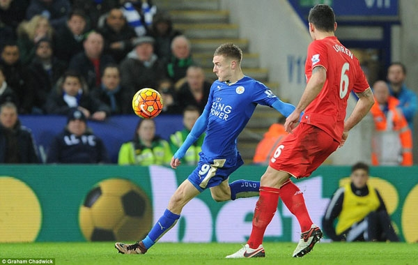 Striker Jamie Vardy prepares to pull the trigger as he runs on to Riyad Mahrez's brilliant long ball over the top of the Liverpool defence