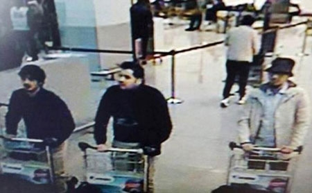 This CCTV image from the Brussels Airport surveillance cameras made available by Belgian Police, shows what officials believe may be suspects in the Brussels airport attack on March 22, 2016. The lone survivor of the three - the man on the right - is suspected to be one of the three currently charged.