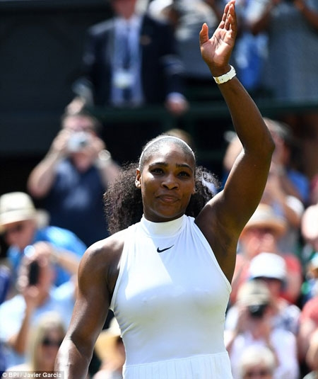 Serena waves to the crowd after booking her place against either sister Venus or Angelique Kerber in the final