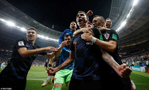 The Croatian players rush to congratulate the match-winner Mandzukic on their way to their first ever World Cup final