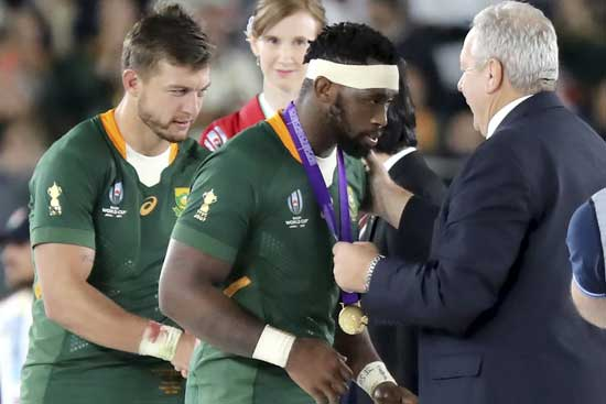 South Africa's captain Siya Kolisi receives gold medal after South Africa won over England in the Rugby World Cup final at International Yokohama Stadium in Yokohama, Japan, Saturday, Nov. 2, 2019. (AP Photo/Eugene Hoshiko)