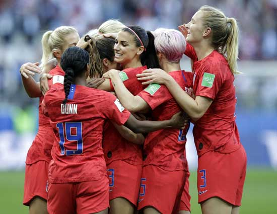 United States' Alex Morgan, center, celebrates after scoring the opening goal during the Women's World Cup Group F soccer match between United States and Thailand at the Stade Auguste-Delaune in Reims, France, Tuesday, June 11, 2019. (AP Photo/Alessandra Tarantino)