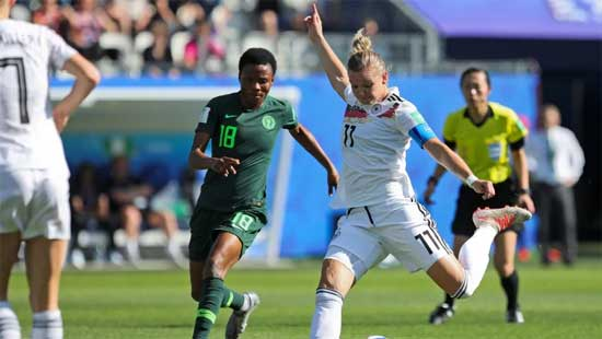 Germany's Alexandra Popp, right, shoots the ball next to Nigeria's Halimatu Ayinde during Germany's 3-0 win in the Round of 16 at the Women's World Cup on Saturday. (Laurent Cipriani/The Associated Press)