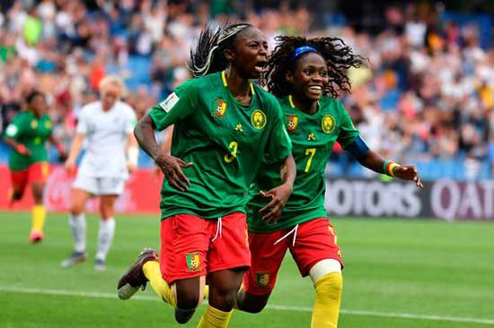 Cameroon's forward Ajara Nchout (l) celebrates after scoring her second goal during the Women's. Image credit - News wires