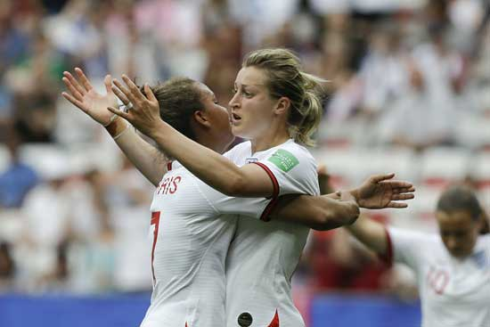 England's Ellen White, right, celebrates with England's Nikita Parris after scoring her side's second goal during the Women's World Cup Group D soccer match between England and Scotland in Nice, France, Sunday, June 9, 2019. (AP Photo/Claude Paris)