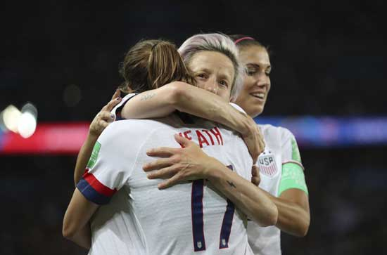 United States' Megan Rapinoe, center, celebrates with United States' Tobin Heath after scoring her side's second goal during the Women's World Cup quarterfinal soccer match between France and the United States at the Parc des Princes, in Paris, Friday, June 28, 2019. (AP Photo/Francisco Seco)