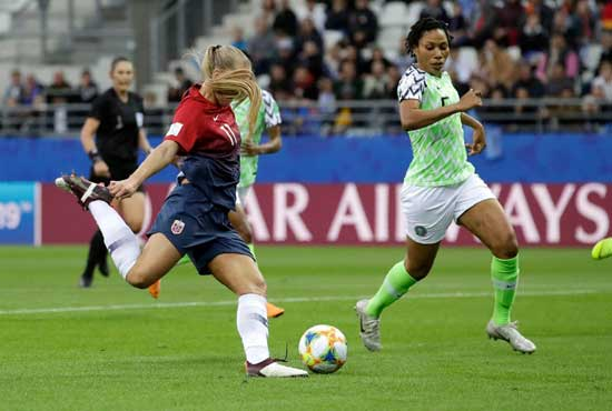 Norway's Lisa-Marie Utland, left, kicks the ball past Nigeria's Onome Ebi to score her team's second goal during the Women's World Cup Group A soccer match between Norway and Nigeria at stadium Auguste Delaune in Reims, France, Saturday, June 8, 2019. (Alessandra Tarantino/Associated Press)