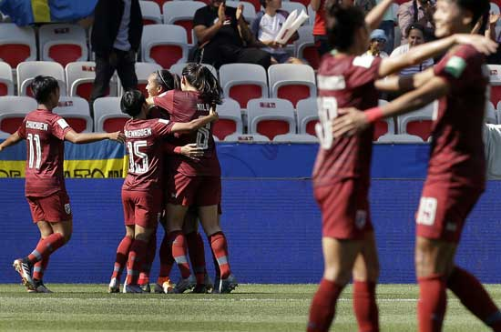 Thailand's players celkebrate their side's first goal scored by Kanjana Sung-Ngoen during the Women's World Cup Group F soccer match between Sweden and Thailand at the Stade de Nice in Nice, France, Sunday, June 16, 2019. (AP Photo/Claude Paris)